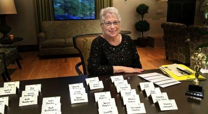 Joan Carman at reception table-sm