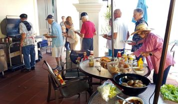Guests line up for burgers & dogs at Summer BBQ 7-18-19-sm
